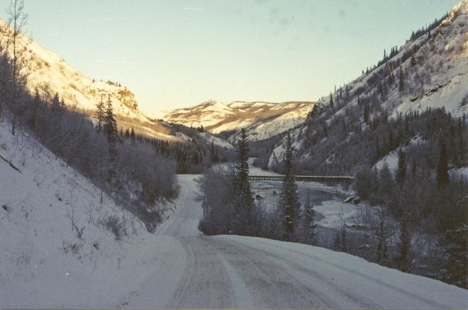 TC winter light rising beyond dip in road